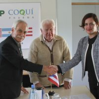 Three people, signing contract